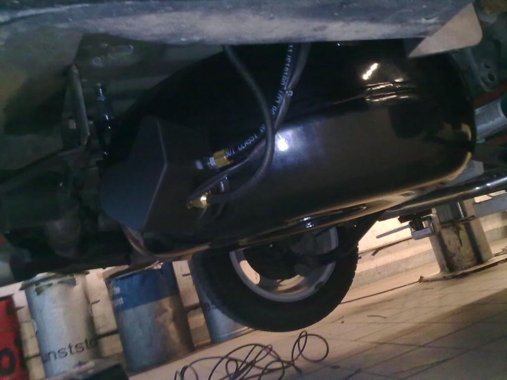 Autogas-Umruestung-LPG-Frontgas-Peugeot-206-Tank-1024x768